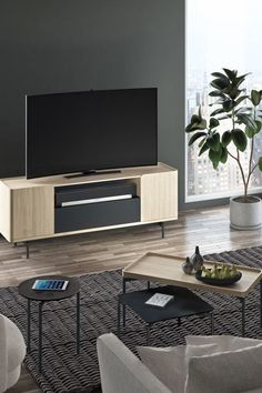 The Radius 8839 entertainment console and credenza is paired with the unique and equally beautiful Radius tables by BDI Furniture.
