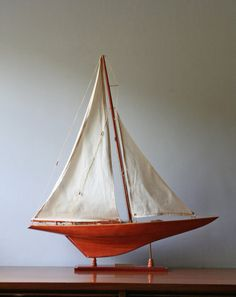 This lovely vintage sailboat is for sale from ModishVintage on etsy for $76. I've been coveting one of these for a while now - for no especially good reason.