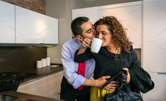 Happy businessman embracing and kissing woman at breakfast by davidpereiras on @creativemarket