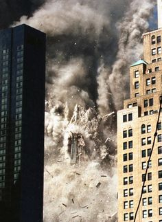 Twin Towers Of The World Trade Center Burn Behind The Empire State Building World Trade Center Collapse, World Trade Center Buildings, World Trade Center Attack, Trade Centre, Guernica, Monuments, 911 Twin Towers, Remembering September 11th, North Tower