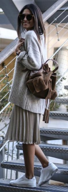Federica L. + seriously cute fall style + knitted sweater + pleated skirt + plain sneakers + casual + seasonal vibes. Skirt/Sweater: Zara.