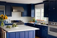 images of kitchens with dark blue cabinets | Bonus Steps: New Hardware and Glass Insets.