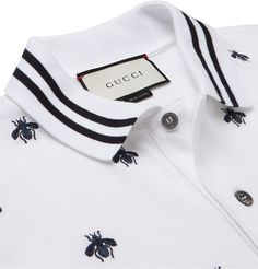 Bees are a key element of recent <a href='http://www.mrporter.com/mens/Designers/Gucci'>Gucci</a> collections and the main feature of this Italian-made polo shirt. The insect is skilfully embroidered all over the front, with a single creature picked out in a contrasting light-blue tone. It's been made with plenty of stretch to ensure the soft cotton-piqué is comfortable. Cut in a neat slim fit with ribbed and stripe-tipped trims, this...