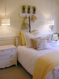 yellow cottage bedroom... Love the hanging lights over the nightstand and the scalloped chair rail. Great for little girls room