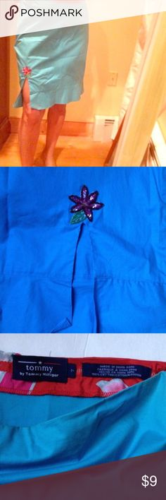⭐️Tommy Hilfiger blue cotton skirt Excellent condition. 100% light cotton. blue skirt with slit in front, embellished with beaded flower above the slit.  Side zipper closure. Some discoloration on sides of waist. Barely noticeable. Approximate measurements: length; 19 1/2 inches. Waist; 15 inches. slit opening 5 1/2 inches.  Size 7 🛍BUNDLE=SAVE  🚫TRADE  🖲USE BLUE OFFER BUTTON TO NEGOTIATE   ✔️Ask Questions Not Answered in Description--Want You to Be Happy! Tommy Hilfiger Skirts Midi