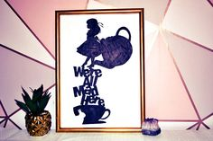 What is this?  A fab monochrome picture of Alice in wonderland featuring the mad hatters famous quote - were all mad here. In my house as well as my mums, we have a long standing joke about this! We all know someone who is just a little bonkers, and this was mad with that in mind