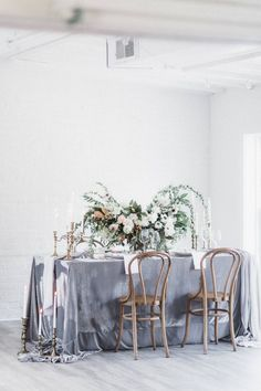 Understated yet luxurious, this silky velvet tablecloth has a bit of spandex so it drapes beautifully over the edges of the table. Its cool gray tone gives it a wintry vibe. Grey Tablecloths, Wedding Tablecloths, Wedding Table Linens, Wedding Reception Decorations, Table Decorations, Wedding Tables, Centerpieces, Camp Wedding, Wedding Gold
