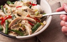 An easy Thai green curry chicken thigh recipe with coconut milk, lime, green curry paste, green beans, and red bell peppers.