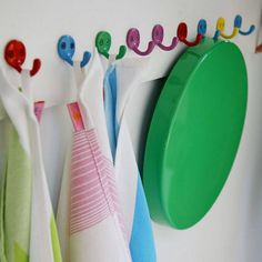 """Colourful metal hooks. """"Fun"""". Would be nice all put together on a plank of wood. I don't underestimate how useful hooks can be, esp in a kiddiwink's room - they're the easiest thing for children to use!"""