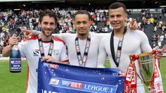 MK Dons: Celebrating promotion to the Championship