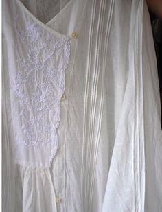 White on white embroidery and pin tucks.