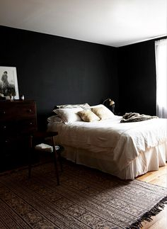 bedroom with white bedding and black walls