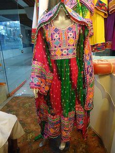 Afghan Kuchi Wedding Dresses http://folkmarket.com/wears-4/traditional-clothing/afghan-dresses-pink-green.html