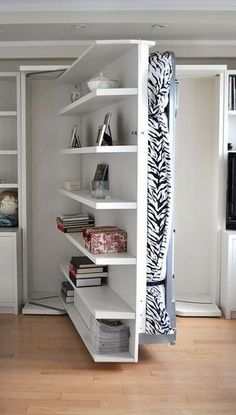 [QUESTION] How do you build a DIY murphy bed? What is the process to build a murphy bed? [ANSWER] The Murphy bed is a cross between a cabinet and a bed. It is commonly referred to as a pull-down bed, wall bed or fold-down bed. Cama Murphy Ikea, Small Apartments, Small Spaces, Small Space Bed, Small Couch, Small Sectional, Sectional Sofas, Revolving Bookcase, Modern Murphy Beds
