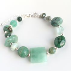 Handmade bracelet with various green gemstones and details in 925 sterling silver. by Penello on Etsy https://www.etsy.com/listing/262747457/handmade-bracelet-with-various-green