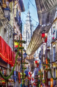 Corpus Christi is one of the most important festivities in Toledo (Spain). The streets are filled with ancient guilds' awnings and beautiful plants adorn the balconies to perform the ancient and traditional procession in which we can see brotherhoods, knights, floats...