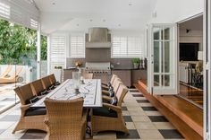 Outdoor kitchen and dining space - love the French doors