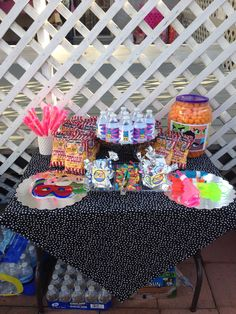Sweets, snacks and toys table. Masks, bubble guns, lollipops, cheese balls, popcorn, gummy worms, cookies in little teen titans go baggies! Ohh and don't forget the teen titans go water! Teen titans go party!!!