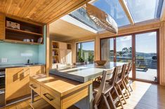 The Hawke& Bay beach house has views to die for - and won& harm the planet.
