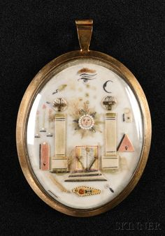 EUROPEAN FURNITURE & DECORATIVE ARTS - SALE 2615B - LOT 788 - MASONIC PENDANT, 18TH CENTURY, OVAL SHAPE WITH APPLIED AND PAINTED MASONIC SYMBOLS IN A GOLD-TONE FRAME, SIGHT LG. 1 7/8 IN. - Skinner Inc