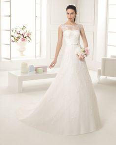 Vestido bordado pedreria y tul en color natural. Vestido bordado pedreria y tul en color blanco.