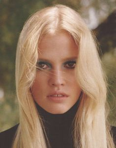 Love this 70s look with long layers and golden blonde hair as seen on Lara Stone