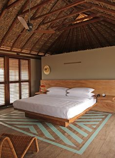 Bedroom of Hotel Escondido in Mexico with Blue-Green Painted Striped Floor and Thatched Palm Roof, Remodelista