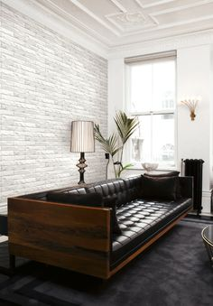 Modern and sleek white stone wallpaper from Wallquest's collection Structure. Industrial inspired wallpaper.