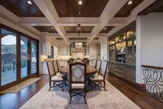 Big windows, dark wood floors and a coffered wood ceiling to match give this amazing dining room a definite wow factor! Designed by Utah's luxury interior design firm, Lisman Studio!
