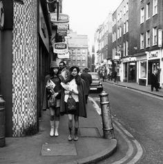 circa 1967: Two young women walk down the street. | 14 Marvellous Photos Of Carnaby Street In The '60s