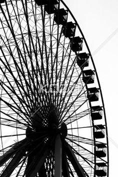 silhouette image of ferris wheel at amusement park. - Low angle silhouette image of ferris wheel at amusement park.