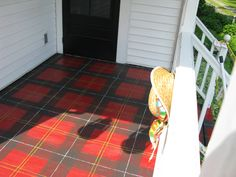 plaid painted porch floor.... base coat red.... use floor boards to measure for verticals... pencil out horizontals... just used sponge and line brushes and free-handed it :)