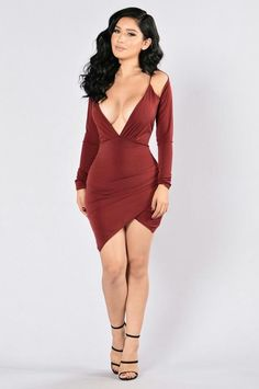 a130ede09b Available in Burgundy - Deep V - Shoulder Cutout Details - Asymmetrical Hem  - Long Sleeve - Made in USA - Polyester