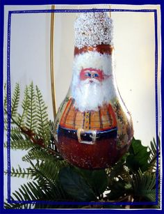 Hand Painted Santa Christmas Tree Holiday Ornament on Recycled  Light Bulb. 28.50, via Etsy.
