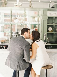 A kiss in a cafe: http://www.stylemepretty.com/little-black-book-blog/2015/02/19/west-village-engagement-session-2/ | Photography: Judy Pak - http://judypak.com/