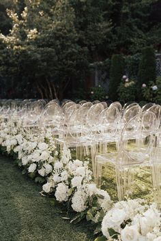 outdoor-wedding-ceremony-on-grass-lawn-guest-chairs-ghost-clear-white-rose-hydrangea-stock-greenery # Outdoor Weddings isle Ghost Chairs & Ivory Flowers at Ceremony Outdoor Wedding Flowers, White Roses Wedding, Outdoor Ceremony, Hydrangea Wedding Flowers, White Wedding Flower Arrangements, White Weddings, Outdoor Weddings, Floral Arrangements, Wedding Isle Decorations