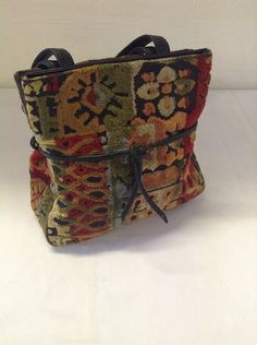 Vintage Carpet Vinyl  Women's Purse or Hand Bag Vintage Multi Color Red Green Blue Black and Gold Carpet Vinyl   Purse No. 9 by ReEmporium on Etsy https://www.etsy.com/listing/247125916/vintage-carpet-vinyl-womens-purse-or