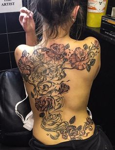 Flowers tattoo for women - 100 Awesome Back Tattoo Ideas