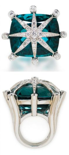 An apatite and diamond ring, Tony Duquette the cushion-shaped apatite centering a round brilliant-cut diamond starburst within a heavy openwork mount; signed Tony Duquette; apatite weighing approximately: 82.85 carats; estimated total diamond weight: 1.85 carats; mounted in eighteen karat white gold.*