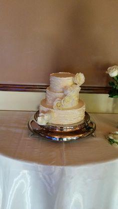 buttercream ruffle design with fresh floral cascade www.weddingsbyholiday.com
