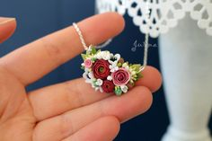One of a kind very feminine floral necklace is made from high quality polymer clay. In this flower composition you can find ranunculus, roses, anemones and