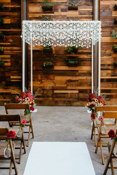 Rings and Flowers Chuppah from Chuppah Studio. Photo by Tory Williams Photography, flowers by Molly Oliver Flowers at Brooklyn Winery