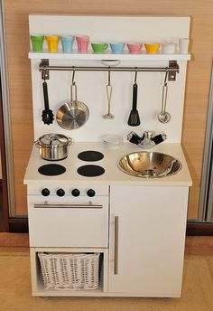 "Ikea hackers play kitchen. Love the stove top ""burners"" (coasters) and light under the top shelf."