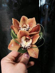 Rusty orange cymbidium boutionnere Orchid Boutonniere, Boutonnieres, Cymbidium Orchids, Orange Flowers, Flower Arrangements, Succulents, Wedding Decorations, Wedding Day, Bouquet