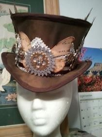 Steampuck Hat - diy duct tape top hat - adapted from another one and that link in here too.  Would this work for your costume with adjustments?
