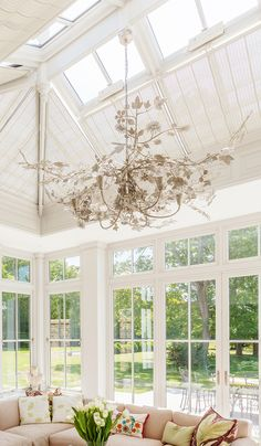 A breathtaking chandelier inspired by the idea of sunlight shining through a tree canopy Conservatory Lighting, Conservatory Interiors, Conservatory Furniture, Roof Lantern, Garden Houses, Tree Canopy, Luxury Living, Sunlight, Valance Curtains