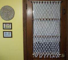 Macrame curtain or wall hanging by KnotsEverywhere on Etsy, $25.00