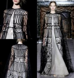 Chanel Haute Couture SS13  You can faintly see the embroidered birds and butterflies peaking out from the 500-hours-of-handpiping 'cage' cape