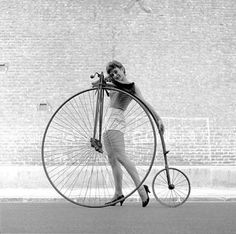 Frances Pidgeon with a penny farthing bicycle, 1956 - Ken Russell