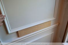 How to install upper panels - How to install picture frame moulding wainscoting - addicted2decorating.com